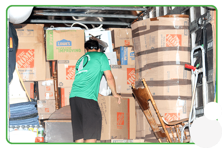 This image shows a professioanl mover packing a large moving truck