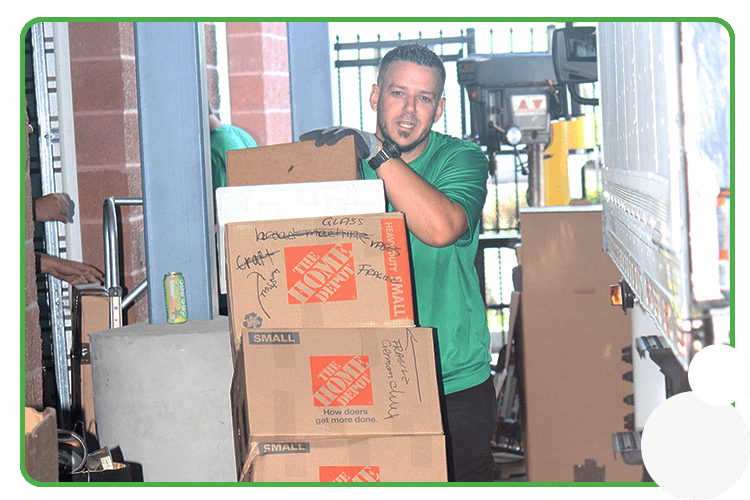 Image: A Perfect Mover moving boxes with a dolley
