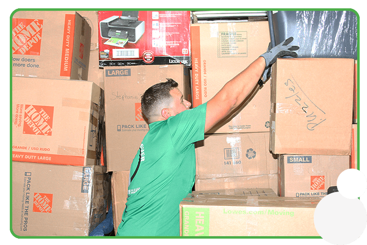 Image: a professional mover stacking boxes for a move