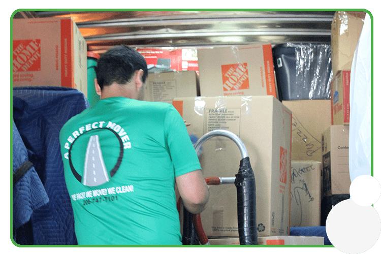 Image: A Perfect Mover crew member moving boxes into a truck