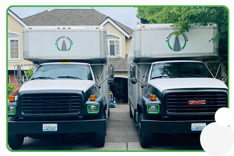 Pictured: 2 A Perfect Mover trucks parked at a residential address