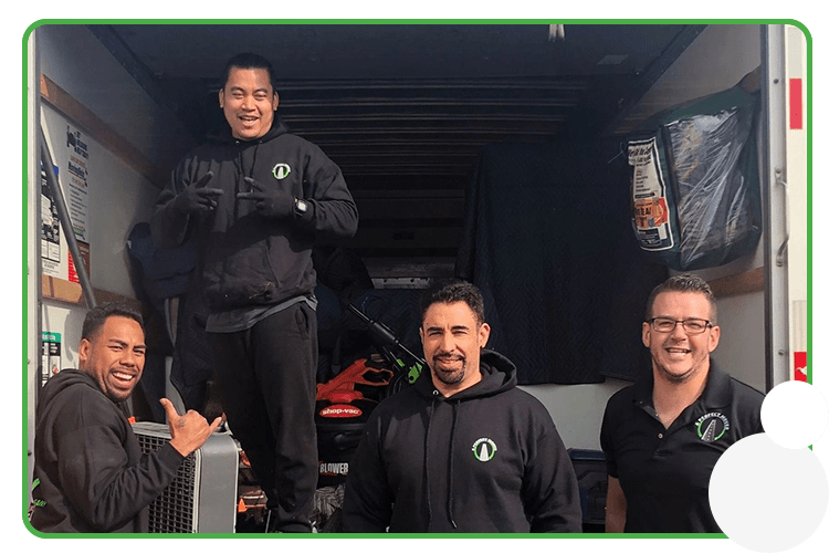 Image: A Perfect Mover crew in uniform with moving truck