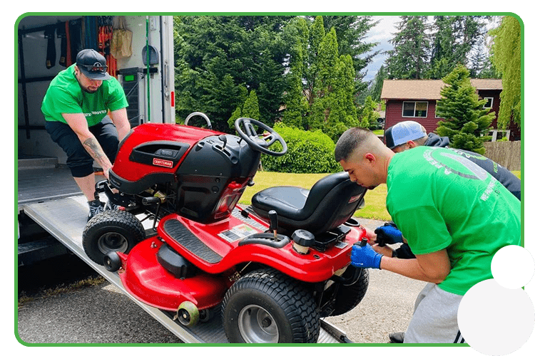 Image: A Perfect Mover crew moving a riding lawn mower