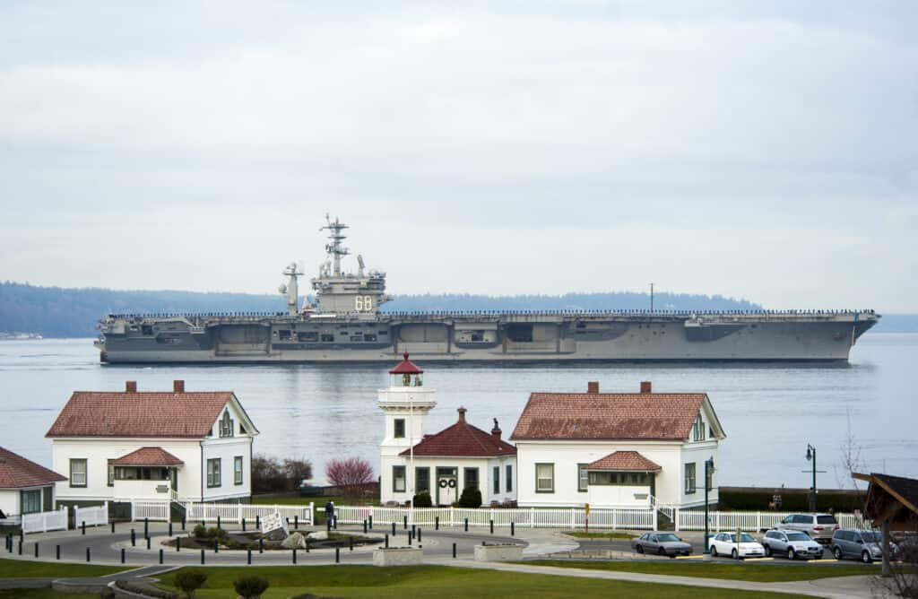 The USS Nimitz as it arrives at homeport in Everett, WA